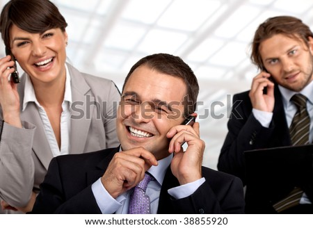 three happy business people talking on their cellular phones - stock photo