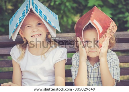 Three happy children  playing in the park at the day time. Concept Brother And Sister Together Forever - stock photo