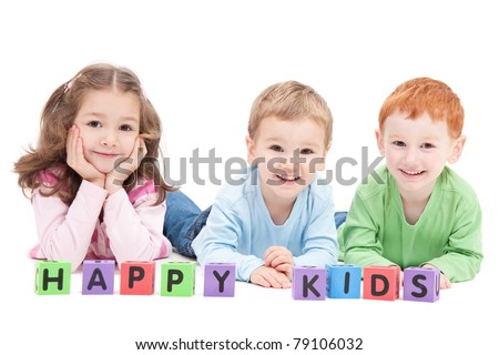 Three happy children with kids blocks. Isolated on white. - stock photo