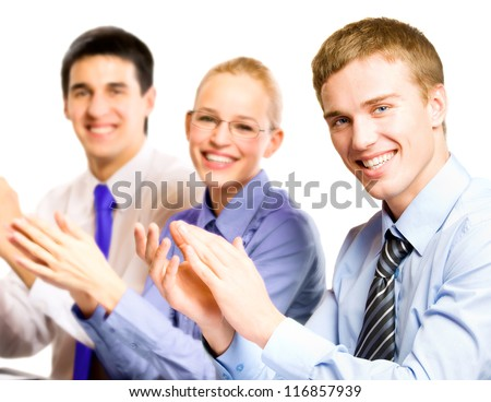 Three happy clapping businesspeople at presentation, meeting, seminar or conference - stock photo