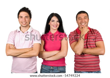 Three happy firiends wearing different pink color  t-shirts and standing in a row  with hands crossed facing camera isolated on white background