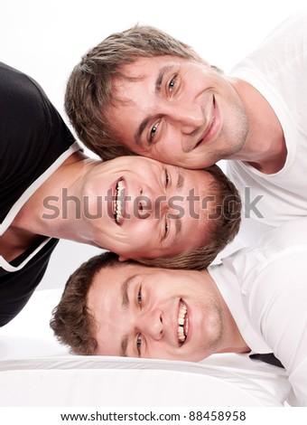Three happy friends having fun on a white background - stock photo