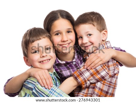 Three happy kids hugging together, isolated on white - stock photo