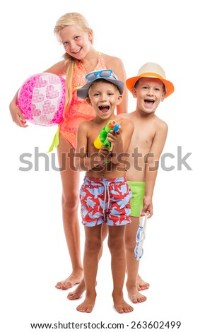 Three happy kids in a swimsuit standing together, isolated on white - stock photo