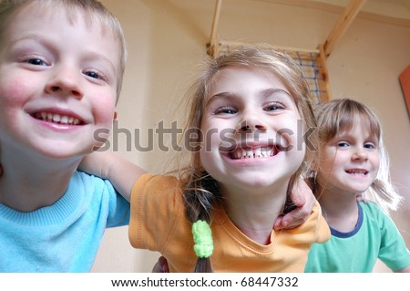 three happy kids playing together - stock photo