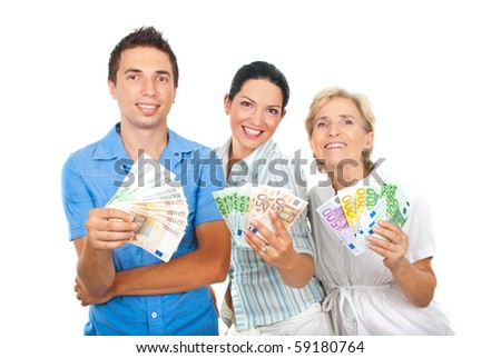 Three happy people in a row holding a lot of money and smiling isolated on white background - stock photo