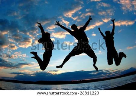 Three happy people jumping. - stock photo