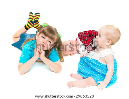 Three happy sisters on a white background - stock photo