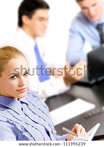 Three happy smiling successful business people working, isolated over white background - stock photo