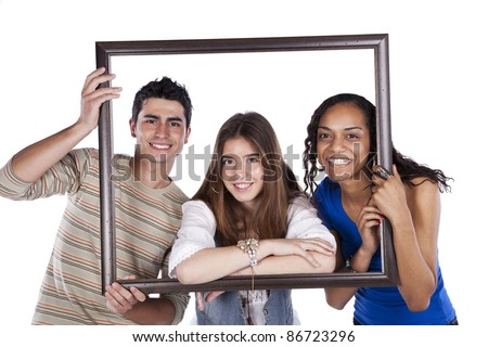 Three happy teenager friends inside a picture frame (isolated on white) - stock photo