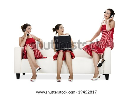 Three happy twin sisters seated on a couch doing diferent activities - Picture collage of the same woman in diferent poses - stock photo