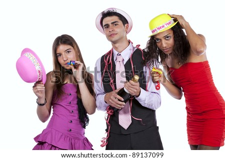 Three happy young friends celebrating the New Year party (isolated on white) - stock photo