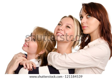 Three happy young women posing together standing behind each other in a row looking upwards with cheerful smiles isolated on white - stock photo