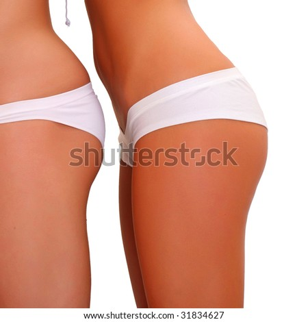 Three harmonous suntanned young women in a profile, in white underwear, isolated on a white background, please see some of my other parts of a body images