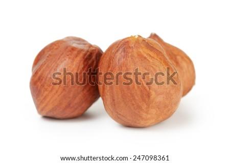 three hazelnut kernels isolated on white background - stock photo