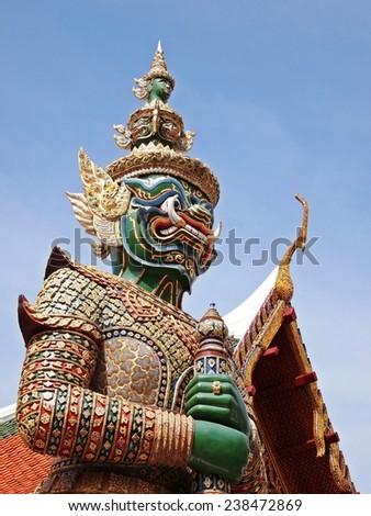 Three Headed Green Guard Statue at Emerald Buddha Temple Grand Palace Bangkok - stock photo