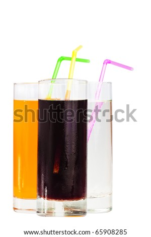 Three highball glasses of soda with drinking straws on a white background - stock photo
