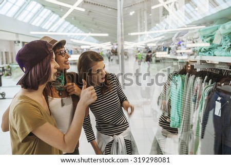 Three Hipster Females In Shopping Mall - stock photo