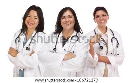 Three Hispanic Female Doctors or Nurses Isolated on a White Background. - stock photo