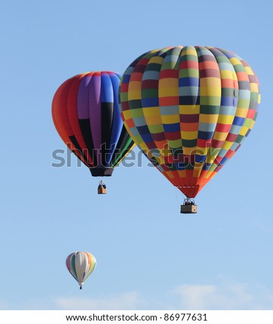 Three hot air balloons floating in the air - stock photo