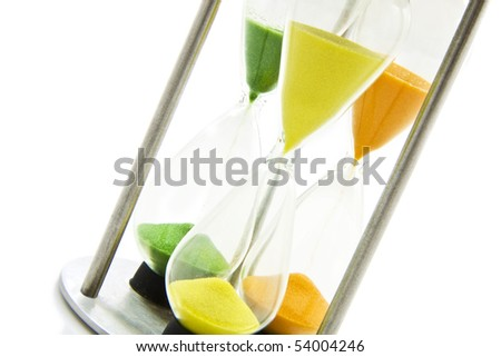 Three  hourglasses with colorful sand  isolated over white - stock photo