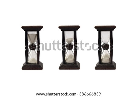 Three hourglasses with different sand level show passage of time isolated on white background - stock photo