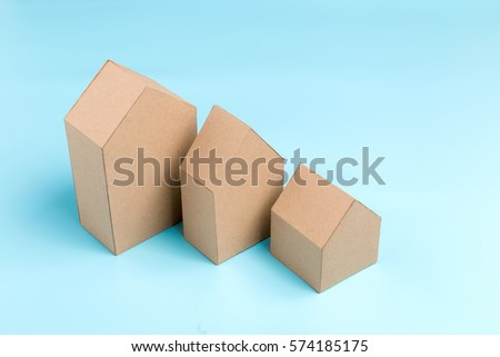 three house model cardboard with free copyspace house loan business concept