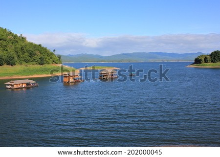 Three houseboat on water nature background