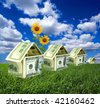 Three houses on a lawn - stock photo