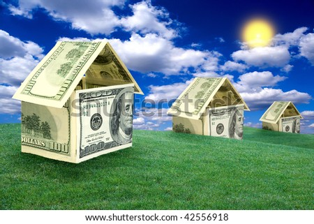 Three houses on a lawn