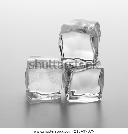 Three ice clear cubes