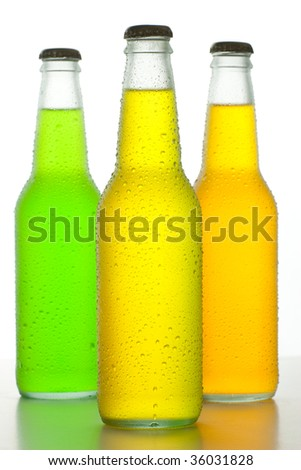 Three ice cold bottles with tropical drinks