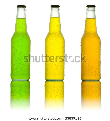 Three ice cold drinks on reflective table - stock photo