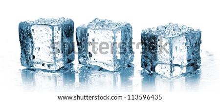 three ice cubes in row on white - stock photo