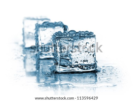 three ice cubes on white - stock photo