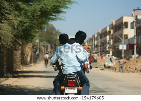 Three Indian boys on the motor bike - stock photo