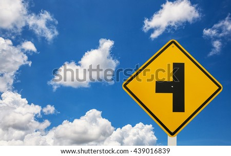 Three Intersection Sign and blue sky with cloud - stock photo