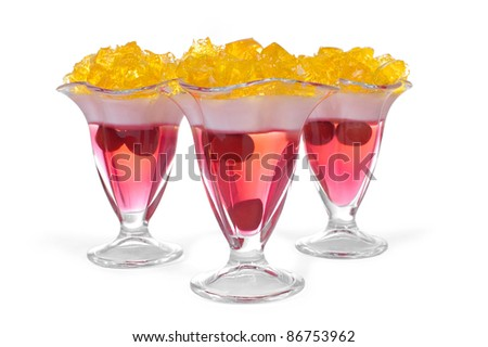 three isolated colored jelly dessert on a white background - stock photo