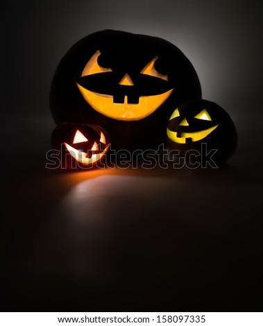 Three jack-o-Lantern at dark
