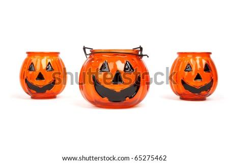 three Jack-o-lantern halloween candle holders isolated on white background - stock photo