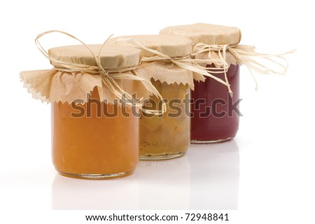 Three Jam jar isolated on a white background. Apples, cabbage-cardamom jam jar, Orange jam and Currant jam jar. With clipping path. Shallow DOF. Focused on the front. - stock photo
