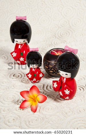 Three Japanese doll on paper background - stock photo