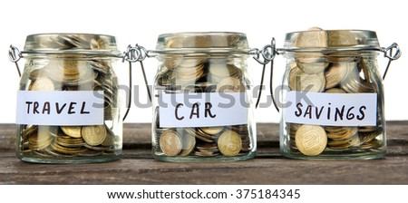Three jars for different needs full of coins - stock photo