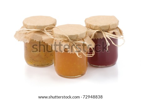 Three jars of jam isolated on a white background.   Apples, cabbage-cardamom jam jar, Orange jam and Currant jam jar. With clipping path. - stock photo