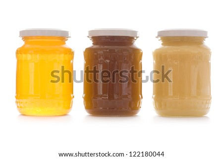 Three jars of sweet honey in row isolated on white