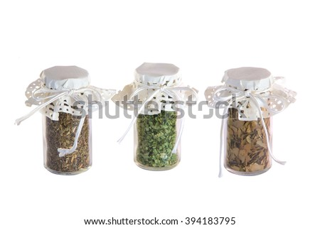 three jars with spices isolated over white - stock photo