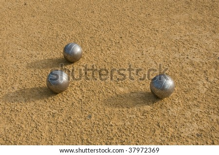 three Jeu de Boule balls - stock photo