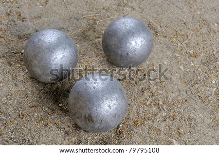 Three jeu de boules balls together at the ground - stock photo