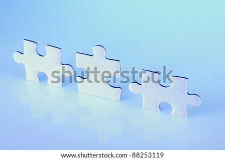 Three jigsaw puzzle pieces - stock photo