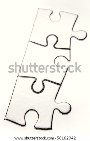 Three jigsaw puzzle pieces on white - stock photo